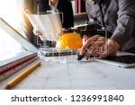 two colleagues discussing data... | Shutterstock . vector #1236991840