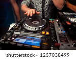 dj mixes the track in the... | Shutterstock . vector #1237038499