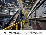 moving conveyor transporter on... | Shutterstock . vector #1237090219