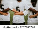 Female Soccer Players Huddling...