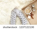 woman feet in polka dot socks... | Shutterstock . vector #1237122130