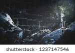 homeless child standing and... | Shutterstock . vector #1237147546