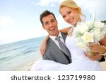 groom holding bride in his arms ...   Shutterstock . vector #123719980
