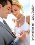 bride and groom exchanging...   Shutterstock . vector #123720004