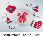 gift box with red sock and... | Shutterstock . vector #1237210426