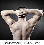 back of a muscular man naked...   Shutterstock . vector #123722590