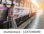 traveler with baggage and... | Shutterstock . vector #1237240690