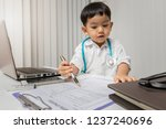 little boy in medic uniform... | Shutterstock . vector #1237240696