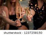 female friends make toast as... | Shutterstock . vector #1237258150