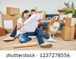 young couple with dog and... | Shutterstock . vector #1237278556
