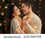 young couple is in christmas... | Shutterstock . vector #1237305709