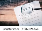 check list sheet and magnifying ... | Shutterstock . vector #1237326463