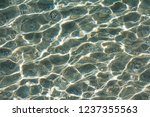 sun glare on the seabed | Shutterstock . vector #1237355563