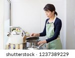 a japanese woman who opens a... | Shutterstock . vector #1237389229