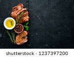 meat steaks with rosemary.... | Shutterstock . vector #1237397200