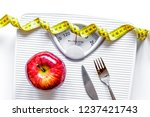floor scale and apple on white... | Shutterstock . vector #1237421743