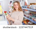 adult positive woman buyer... | Shutterstock . vector #1237447519