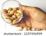 dried pistachio nuts in class... | Shutterstock . vector #1237456909