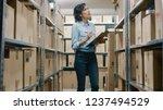 female inventory manager checks ... | Shutterstock . vector #1237494529