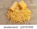 Shredded cheddar cheese on a...