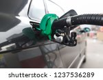 fueling car with petrol pump at ... | Shutterstock . vector #1237536289