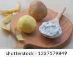 potato starch in a wooden spoon....   Shutterstock . vector #1237579849