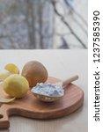 potato starch in a wooden spoon....   Shutterstock . vector #1237585390