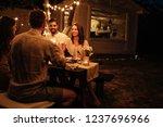 shot of friends having fun at a ... | Shutterstock . vector #1237696966