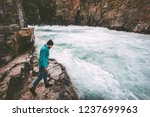 man traveling in river canyon... | Shutterstock . vector #1237699963
