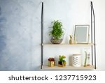 Stock photo shelves with green lucky bamboo in glass bowl and decor on light wall space for text 1237715923