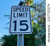 speed limit 15 mph sign against ... | Shutterstock . vector #1237732279
