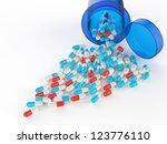 pills spilling out of pill... | Shutterstock . vector #123776110