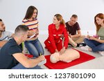 instructor demonstrating cpr on ... | Shutterstock . vector #1237801090