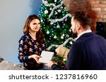 couple giving christmas... | Shutterstock . vector #1237816960