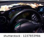 wads of money on the dashboard... | Shutterstock . vector #1237853986
