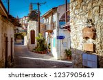 old stone houses on a narrow... | Shutterstock . vector #1237905619