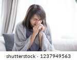 woman sick and sneeze with... | Shutterstock . vector #1237949563