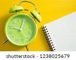 alarm clock on yellow color...   Shutterstock . vector #1238025679