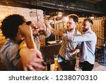 group of drunk men starting a... | Shutterstock . vector #1238070310