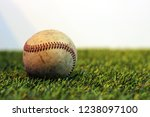 old baseball on grass background | Shutterstock . vector #1238097100