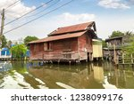 life along the river in bangkok ...   Shutterstock . vector #1238099176