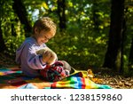 baby boy embrace with teddy.... | Shutterstock . vector #1238159860