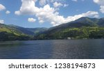 mountains reflecting in water....   Shutterstock . vector #1238194873