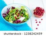 fresh green salad with... | Shutterstock . vector #1238242459