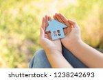 paper house in hand outdoor... | Shutterstock . vector #1238242693