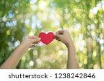 woman hands holding red heart | Shutterstock . vector #1238242846