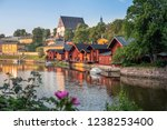 Beautiful city landscape with idyllic river and old buildings at summer evening in Porvoo, Finland