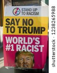 London, United Kingdom, November 17th 2018:- A sign against Donald Trump at The Stand Up To Racism march through central London from the BBC to near Downing Street in Whitehall - stock photo