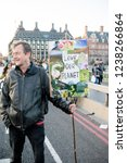 London, United Kingdom, November 17th 2018:- Extinction Rebellion protesters block Westminster Bridge in central London to protest the current environmental emergency - stock photo