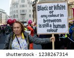 London, United Kingdom, November 17th 2018:- Anti racist proteser at the Stand Up To Racism march through central London from the BBC to near Downing Street in Whitehall - stock photo